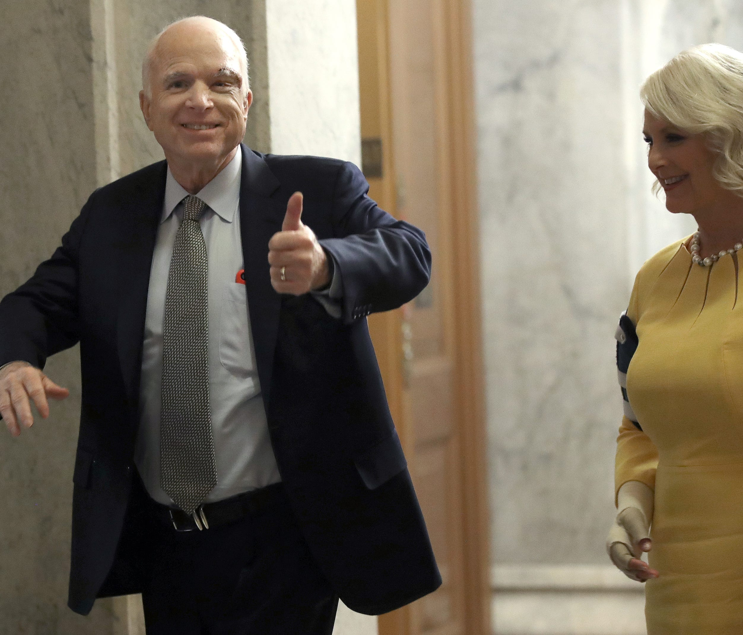 Sen. John McCain returns to the U.S. Senate, accompanied by his wife, Cindy, on July 25, 2017.