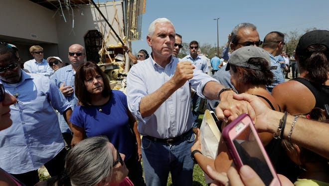 Vice President Mike Pence, center, with his wife Karen, left, greet residents effected by Hurricane Harvey during a visit, Thursday, Aug. 31, 2017, in Rockport, Texas.
