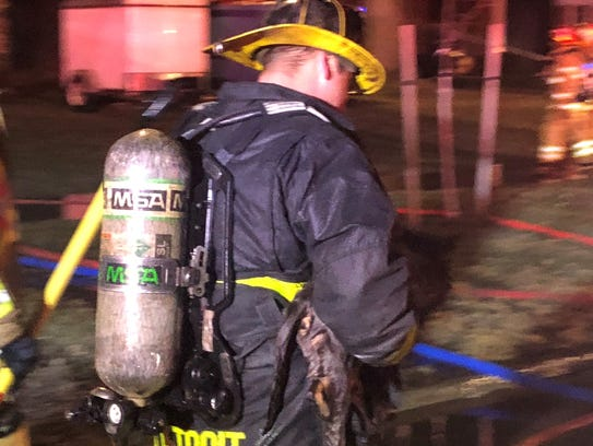 Firefighters rescue a cat from a Grosse Pointe blaze