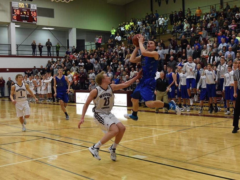 Keegan Van Egdom of Sioux Falls Christian moments before he releases the game-winning bank shot against Western Christian on Feb. 11 in Hull, Iowa.