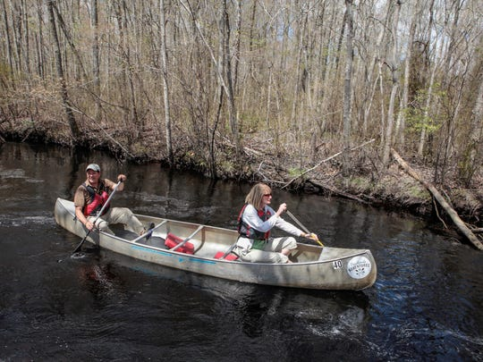 John and Leann Volpa of Evesham paddle on the Mullica River after leaving Pinelands Adventures. The organization offers a variety of kayak and canoe tours.