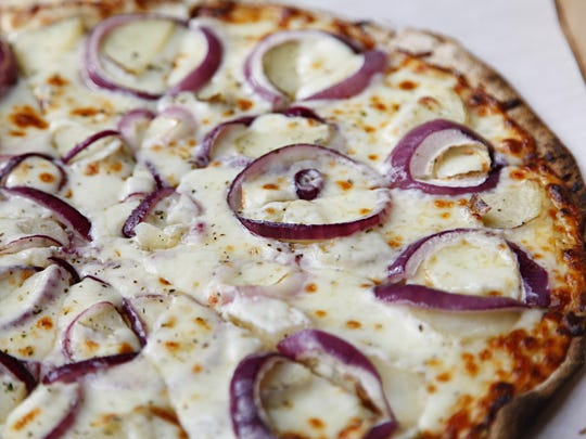 Potato and onion ring pizza from Big Tomato Pizza.