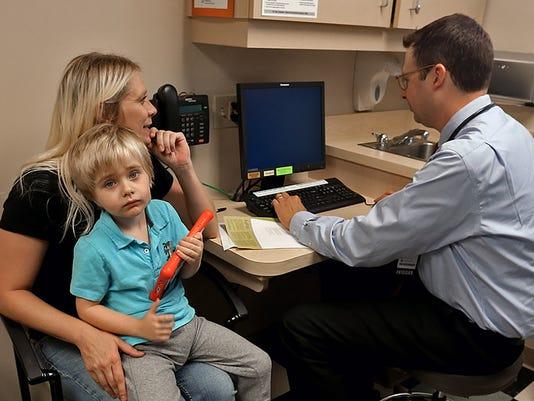 -des.m0825vaccination.bn3.jpg_20140821.jpg