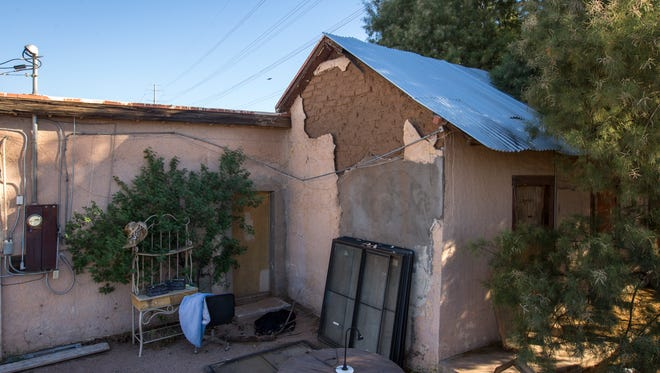 The plaster is falling off the 1860s adobe home Steve Sussex's great-grandparents built near what is now downtown Tempe. Sussex is battling the city to keep the property.