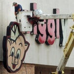 The cartoon pig is coming down to make room for Opelousas' newest supermarket. Cash Saver has opened in the former Piggly Wiggly store located on Heather Drive in Opelousas.