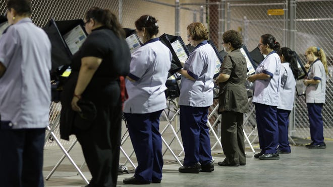 Casino workers vote in 2016 at an early voting site in Las Vegas. Advocates for creating a non-partisan commission to redraw Nevada voting districts face an Aug. 3 deadline to submit signatures to make the 2020 ballot.