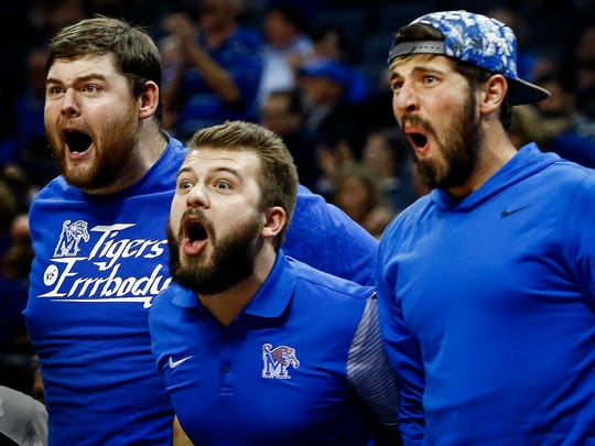 University of Memphis fans (left to right) Brandon Bumgarner, Nathan Bradberry, and Ryne Ladley celebrate a dunk by Tiger Dedric Lawson (not pictured) against University of Texas Rio Grande Valley during first half action at FedExForum.