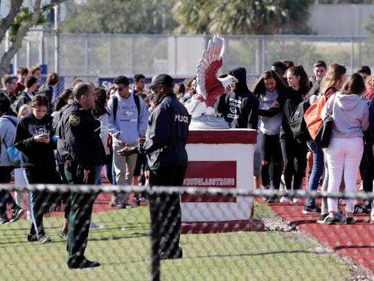 Students at Marjory Stoneman Douglas High School walk