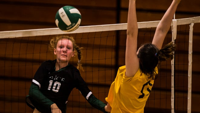 From left, Rice #10 Elizabeth Lyman gets a spike past the block of Harwood #11 Mia Cooper during their volleyball match up Thursday night, October 5, 2017, at Rice Memorial High School in South Burlington.