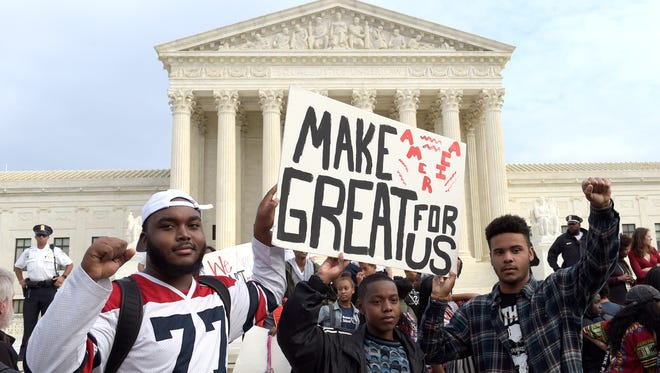 Washington area high school students protest outside the Supreme Court in Washington on Tuesday.