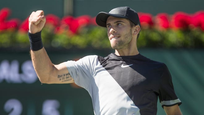 Borna Coric of Croatia celebrates winning the second set against South African Kevin Anderson on Stadium One during their quarterfinal match at the 2018 BNP Paribas Open at Indian Wells Tennis Garden on March 15, 2018. Coric won the match 2-6, 6-4, 6-4, 7-6 (3).