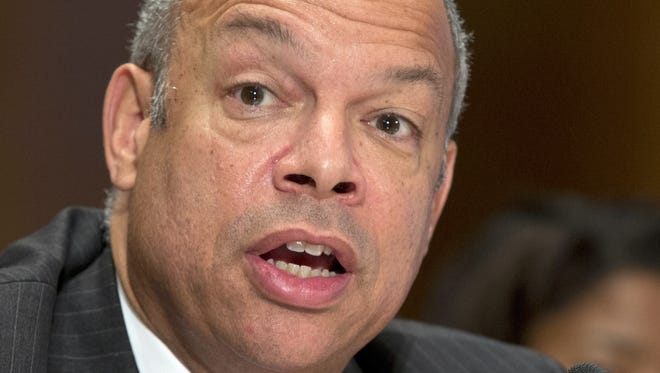 File photo of Jeh Johnson, Homeland Security Secretary, testifying on Capitol Hill in Washington. Johnson said Thursday Feb. 20, 2014, that a warning to airlines that terrorists could try to hide explosives in shoes was a routine advisory issued in response to the latest intelligence.