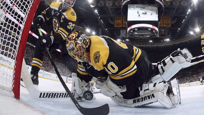 Bruins defenseman Zdeno Chara (left) reaches behind goaltender Tuukka Rask to keep the puck from crossing the goal line during the second period in Game 7 of the Stanley Cup Final against the St. Louis Blues, in Boston. The Bruins lost the game 4-1 and the Cup, 4-3.