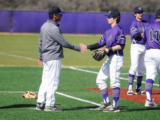 Wylie coach Clay Martin, left, shakes hands with Gatlin