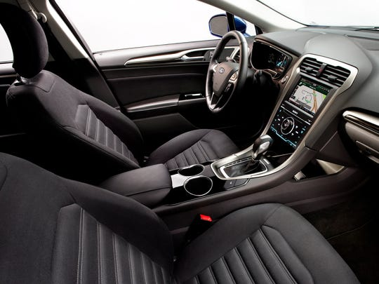 Our test Ford Fusion Hybrid came with heated leather seats, automatic climate control, leather-wrapped multi-function steering wheel, USB input and Bluetooth calling/audio streaming.