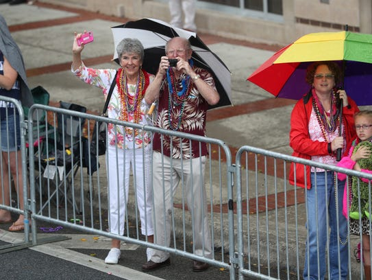 Spectators ride out the rain during Tallahassee's 50th