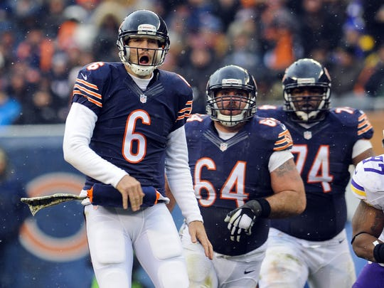 Chicago Bears quarterback Jay Cutler (6) with Chicago Bears center Brian De La Puente (64) and Chicago Bears tackle Jermon Bushrod (74)  in the first quarter of their game against the Minnesota Vikings at Soldier Field.