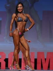 Julia Song, center, took first place in the Bikini Masters, Open and second in Bikini Overall categories at the 2017 NPC Washington IronMan Natural Bodybuilding, Classic Physique, Fitness, Figure, Bikini and Physique Championships in Seattle, Washington.