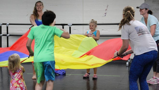 Kids and parents play and move their bodies during a 2017 Dance for All class.