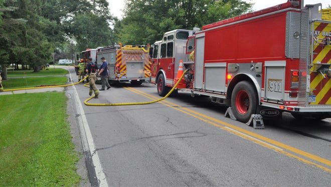Firefighters extinguished a shed fire that spread to a nearby garage on Atkins Road in Port Huron Township on Monday, July 30, 2018.