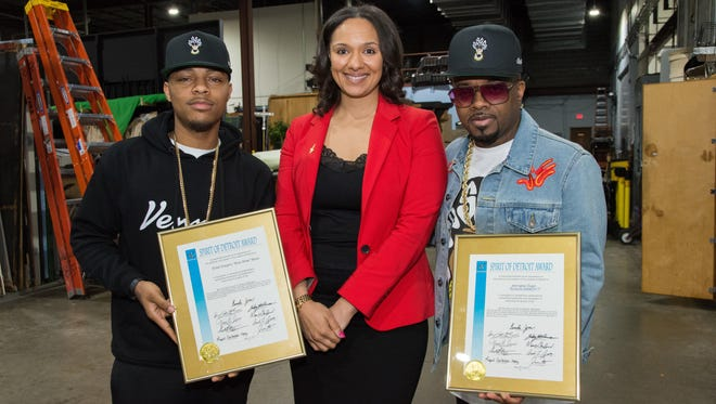 Detroit City Councilwoman Mary Sheffield, center, presented rapper Bow Wow, left, and Jermaine Dupri with awards Friday.