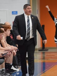 Pleasant coach Ben Snively works the sidelines as the Spartans fell 71-49 to Harvest Prep on Tuesday in a Division III district semifinal at Olentangy Orange.