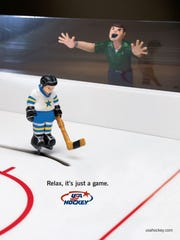"A poster from USA Hockey's ""Relax, it's just a game"""