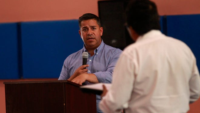 U.S. Rep. Ben Ray Luján answers questions Thursday during a town hall meeting at the Walter Collins Center in Upper Fruitland.