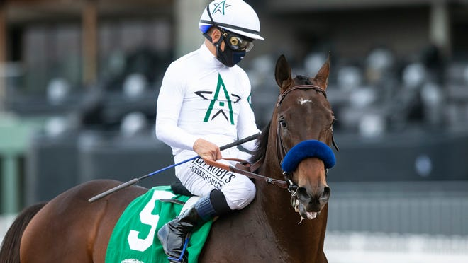 In a photo provided by Benoit Photo, jockey Mike Smith guides Life Is Good to the winner's circle after their victory in the Grade III, $100,000 Sham Stakes horse race, Saturday, Jan. 2, 2021, at Santa Anita Park, in Arcadia, Calif. (Benoit Photo via AP)