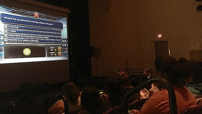 """Chandler High School students participate in """"Cinema Drive,"""" a safe driving program that includes a 3-D film and quizzes."""