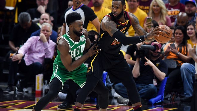 Cleveland Cavaliers forward LeBron James (23) looks to pass in front of Boston Celtics guard Jaylen Brown (7) during the first quarter in game four of the Eastern conference finals of the 2018 NBA Playoffs at Quicken Loans Arena.