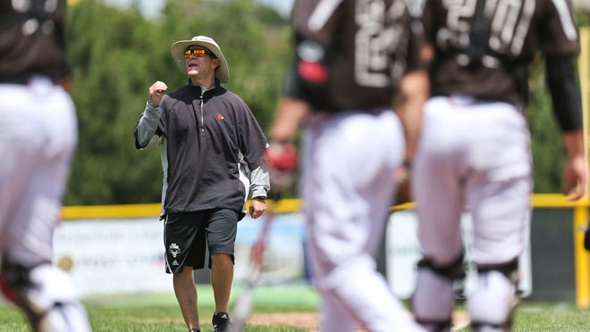 Louisville head coach Dan McDonnell gives instruction during a June 15, 2014, practice ahead of the College World Series.