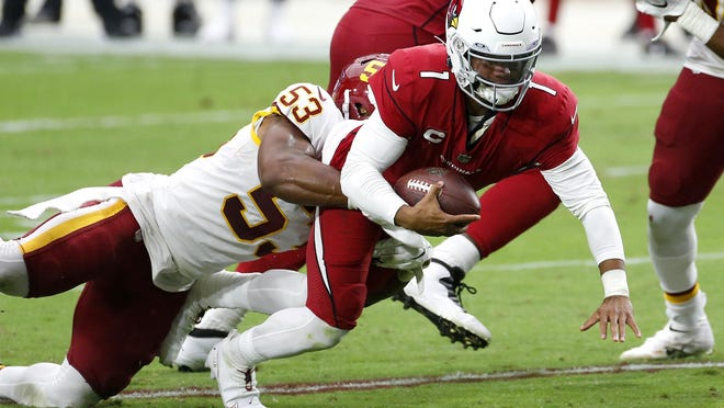 Arizona Cardinals quarterback Kyler Murray (1) is pulled down by Washington Football Team inside linebacker Jon Bostic (53) during the second half of an NFL football game, Sunday, Sept. 20, 2020, in Glendale, Ariz.