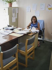 Agnes Cruz, chief financial officer at the Guam Legislature, compiles documents requested by Adelup under the Freedom of Information Act in Agana on Jan. 6.