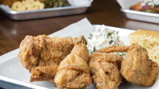 The traditional-style half-chicken dinner, with sides of cole slaw and cornbread at the Crispy Coop.
