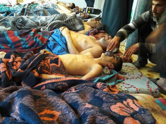 FILE -- In this Tuesday, April 4, 2017 file photo, victims of the suspected chemical weapons attack lie on the ground, in Khan Sheikhoun, in the northern province of Idlib, Syria. Turkey's health minister, Recep Akdag said Tuesday, April 11, 2017, that test results conducted on victims of the chemical attack in Khan Sheikhoun confirm that sarin gas was used. Officials from the World Health Organization and the Organization for the Prohibition of Chemical Weapons participated in the autopsies.
