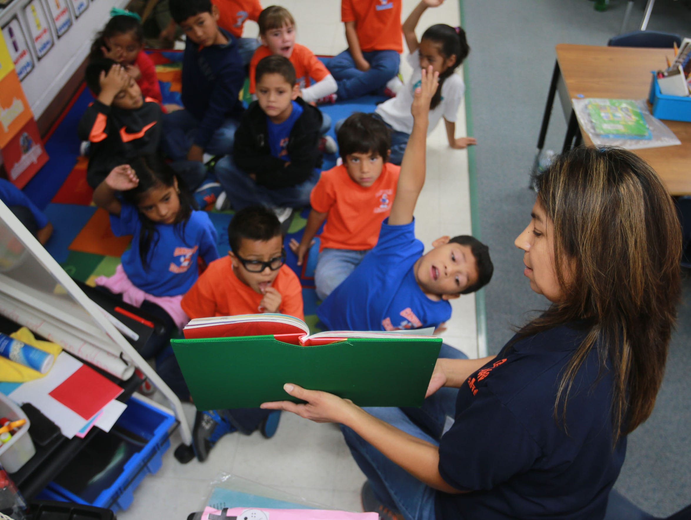 Students read a book at Canutillo Elementary School,