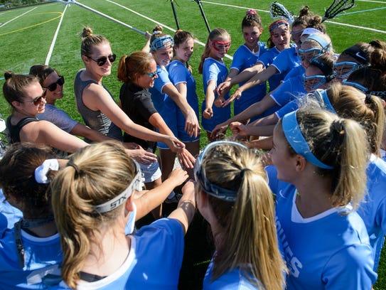 South Burlington huddles together during the girls