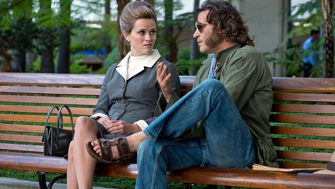 Reese Witherspoon, as Hope Harlingen, and Joaquin Phoenix, as Doc Sportello, in a scene from 'Inherent Vice.'