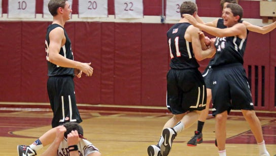 Harrison's Jeff Solmon (1) is overcome with emotion