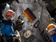 Rescue workers check debris at the crash scene near Seyne-les-Alpes.