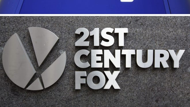 A composite image of signs at a Sky television office in London and 21st Century Fox offices in New York.