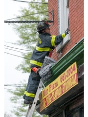 Wilmington Fire Department respond to a three-story building fire Thursday, April 28.