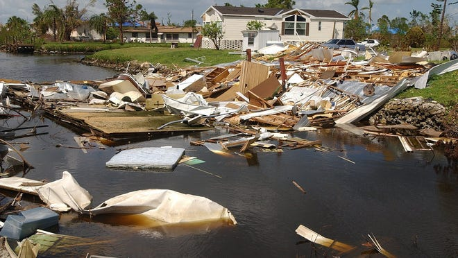 Remains of a mobile home destroyed by Hurricane Charley ended up in this canal in Punta Gorda.