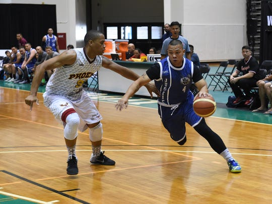 Team Justice player August Sotelo (4) drives the ball baseline against the Auto Spot Phoenix Sons for their Guam Basketball Association playoff game at the University of Guam Calvo Field House in Mangilao on May 1.