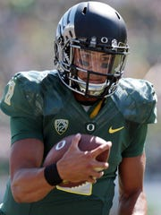 Oregon junior quarterback Marcus Mariota is one of three finalists invited to New York City for Saturday night's Heisman Trophy presentation, and he is considered the overwhelming favorite to win the award.