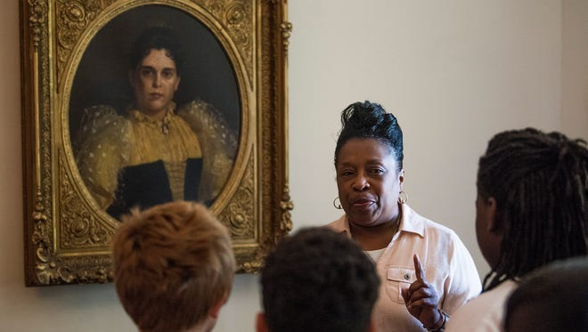 Evelyn England gives a tour of the First White House of the Confederacy to students from Arcadia Elementary School in Tuscaloosa on Friday April 27, 2018 in Montgomery, Ala.