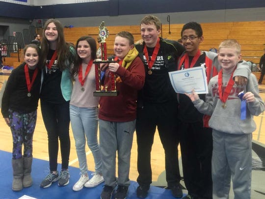 STEM Institute's OM team is pictured at State following being awarded first place in Division 2 and the Ranatra Fusca Creativity Award. Pictured are, from left: Ruby Riegert, Alyssa Janke, Sophie Schmidt, Jared Ott, Mason McGrath, Miles Dennis and Nathan Ott.