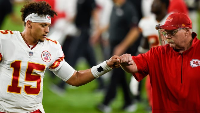 Kansas City Chiefs quarterback Patrick Mahomes (15) and head coach Andy Reid bump fists after an NFL football game against the Baltimore Ravens, Monday, Sept. 28, 2020, in Baltimore. The Chiefs won 34-20.
