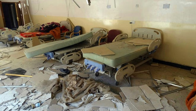 "This Sunday, July 13, 2014 file photo, shows damaged hospital beds after a bombing in al-Karma town, east of Fallujah, Iraq. Iraq's prime minister Haider al-Abadi said Saturday he has ordered the army to stop shelling populated areas held by militants in order to spare the lives of ""innocent victims"" as the armed forces struggle to retake cities and towns seized by fighters of the Islamic State extremist group this summer."